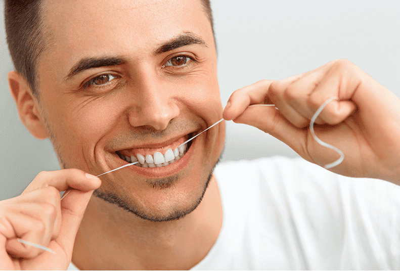 Battle of the Flossers: Traditional String vs. Water Flossing